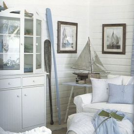 Strandhus med New England inredning.